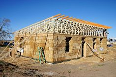 great modern roof line for a strawbale house