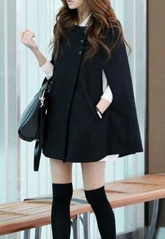 Loving this black cape for a new twist on the traditional black wool coat for winter.