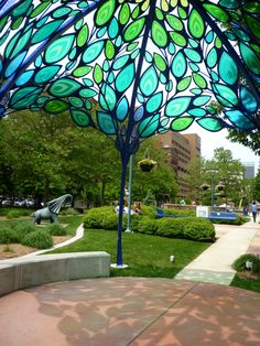 The pergola is not built to give shade as it has number of openings. Gazebo Pergola, Cheap Pergola, Covered Pergola, Pergola Cover, Stained Glass Art, Stained Glass Windows, Glass Garden, Garden Art, Michigan