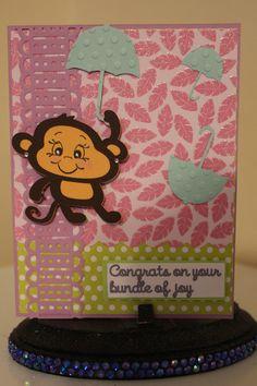 Die cut images ( monkey, umbrella, banner) cricut. MS double edge punch. Swiss Dot cuttlebug folder. Peachy keen face