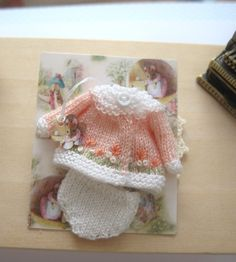 dollhouse baby doll clothes knitted outfit embroidered 12th scale peach by Rainbowminiatures on Etsy