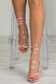Lace up in this sexy satinheel. Pair with your sexy dresses for date night or dress up any basic jeans with these beauties. Adjustable laces feature gold hardw