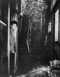 By Brassaï (1899-1984), 1/1948, Giacometti at the door of his studio, rue H. Maindrou, 14e, Paris.