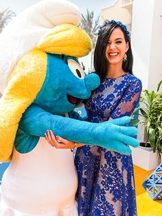 Katy Perry squeezes in a little girl time with her on-screen alter ego, Smurfette, at a photo call for her upcoming film, The Smurfs 2, in Cancun, Mexico, on Monday.