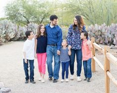 What to wear for family portraits!  Family in cactus garden photographed by Jubilee Family Photography in Gilbert, AZ.