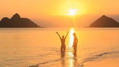 A couple enjoying the water as the sun sets over the sea - Avoya Travel Article: 'Best Budget Cruises for Next Year'