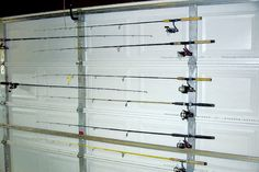 Fishing rod storage on garage door uses U-bolts to hold rods and allow them to rotate when the door opens. Fishing rod storage on garage door uses U-bolts to hold rods and allow them to rotate when the door opens. Fishing Pole Storage, Fishing Pole Holder, Kayak Storage Rack, Door Storage, Garage Storage, Fishing Rods, Ice Fishing, Fishing Lures, Fishing Tackle