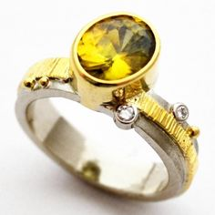 how to say it when you just can't find the words: this ring will say it all.  fresh off the bench, this 14k/18k royal yellow river band featuring natural australian diamonds and showcasing a phenomenol 2.26ct natural sphene will leave you speechless.  just in time for the holidays, from blue by susan west.