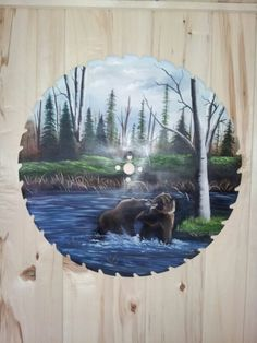 Brown bear saw blade painting by Anne Penman