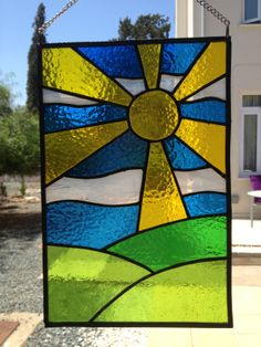 Stained Glass panel hanging in the sun