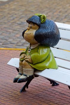 Mafalda has her own statue in San Telmo. There she is, sitting in a bench and dressed like a girl, with a green dress and a bun in her hair. The comic strip, which was created by Quino 45 years ago has being translated to several languages. Mafalda Quotes, Sculpture Art, Sculptures, Heros Comics, Snoopy, Strip, Cold Porcelain, Religious Art, Best Memories