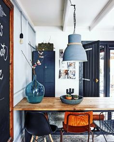 The demijohn. The mismatched chairs. The Vintage school chalkboard. The matte midnight blue painted vintage gym lockers. Im in love... Bring on the grub!!
