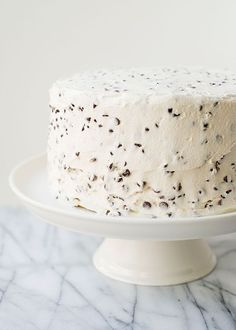chocolate chip layer cake | white cake, white frosting, each with chocolate chips throughout.