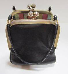 Vintage Bonnie Cashin for Coach black leather double kiss lock purse via Etsy.