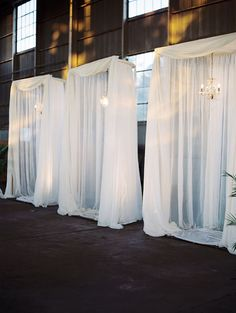 airplane hanger wedding reception. Would be great for covering the walls. Fabric, PVC pipe, and a quick hem?