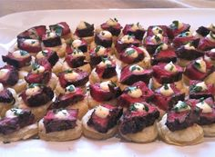 Steered Beef Tenderloin cubes and horseradish cream on top of puff pastry rounds.  These are fantastic and impressive.  They work great at room temperature - always important for a cocktail party food display.
