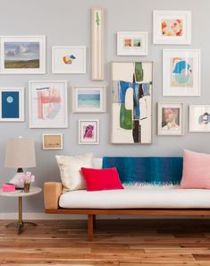 """Gallery wall tips-start with largest frame first and hang off center, mix vertical and horizontal and light and dark frames. Put @ 3 inches between each frame. Center should be about 57"""" from floor?"""