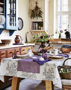 Mixed cabinetry and color refresh. Neutral Country Kitchen with Sketched Floral Table Cloth