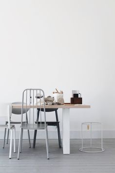 In need of the clean white dining room, grey and black chairs.