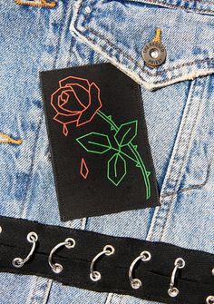 Rosario Patch cryin& under the bright lights. This gorgeous patch features a minimal rose outline graphic with drops fallin& from the petals. Punk Patches, Pin And Patches, Rose Outline, Boy London, Crushed Velvet, Shoulder Bag, Bright Lights, Boutique, Minimal