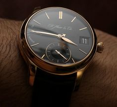 Review, photos, & hands-on video of the H. Moser & Cie Endeavour Perpetual Calendar watch with cleverly laid out calendar display.