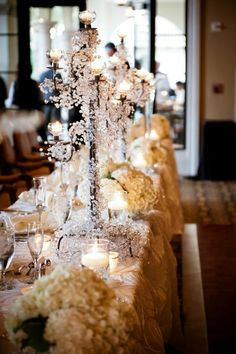 Wow - what a stunning and glamorous wedding table centerpiece! {Palm Beach Photography}