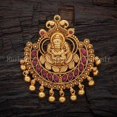 Designer silver temple pendant made of pure 925 silver, plated with gold polish and studded with spinal ruby green stones. #kushaslfashionjewellery #pendants #temple #jewellery #traditional #indian