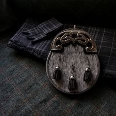 Seen here are the strong lines of the Afro-Celtic Sporrans Contemporary cantle and the misty tones of the pale Nguni skin. It pairs beautifully with #thehouseofedgar #hebridean #cairn #tartan #kilt and flashes. #sporranmaker #leatherwork #sporran #kiltmaker #bespoke #groomstyle #scottishgroom #scottishwedding #chooseWool #staghorn #scottishheritage Kilt Hire, Tartan Tie, Groom Style, Leather Working, Bespoke, Afro, Celtic, Take That, Strong