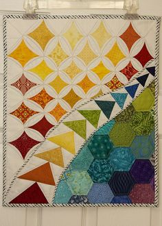 Cathedral windows, flying geese and hexagon doll quilt from Andrea AKA Quiltedoma for Doll Quilt 10.  Posted by Kati | from the blue chair