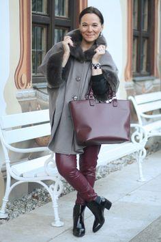 Trendy styling of an elegant faux fur cape