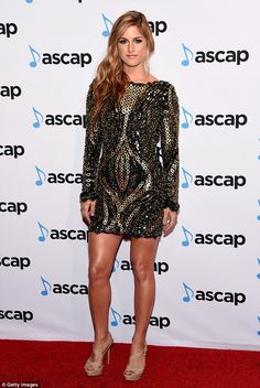 She's got style: The singer-songwriter showed off her flawlessly toned legs in a sequin mini-dress at the ASCAP Country Music Awards