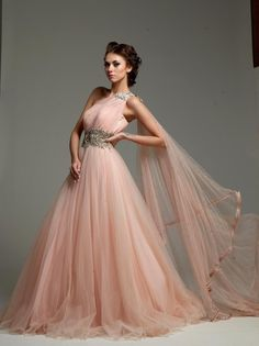 This Indo Western gown is in shaded peach color gorgette fabric. This Indo Western gown is available on discounted price