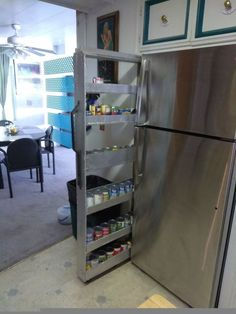 Do THIS in the narrow space next to your fridge and get so much more kitchen storage space!