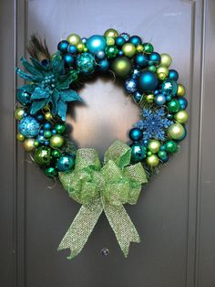 Not my colors this year, but LOVE this! Peacock Christmas Wreath by StacysWreaths on Etsy.