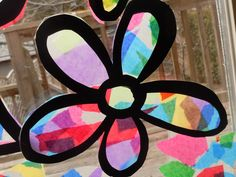 Art project of the day, adaptation for younger children.  Press tissue paper onto clear contact paper (sticky side); make a black frame overlay, such as a cross, butterfly, kite, flower, or star.