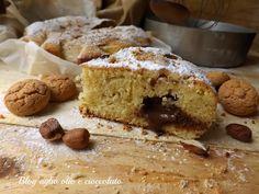 la torta amaretti cioccolato e nocciole è un dolce particolarmente semplice da fare molto morbido e con un cuore di cioccolato molto invitante