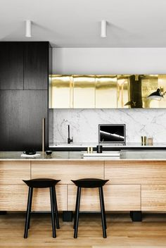 kitchen stools, kitchen island, gold cabinets