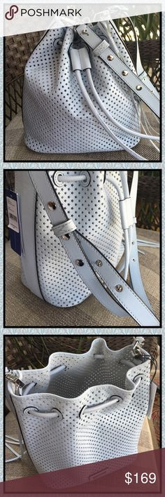 """🆕ADTL PICS OF REBECCA MINKOFF BUCKET BAG ADDITIONAL PICS OF REBECCA MINKOFF STAR PERFORATED BUCKET BAG. PLEASE SEE ORIGINAL LISTING IN CLOSET.   Details: ☆Bleached Blue Leather ☆Unlined ☆Detachable crossbody strap with 21"""" drop ☆Drawstring closure  Measures: ☆10.25"""" H ☆9.75"""" L ☆6"""" W  ♡Includes dust bag & adorable matching passport case in rich saffiano leather, signature logo hardware & 2 interior slip pockets. Measures 4""""L x 0.75""""W x 5.75""""H. Rebecca Minkoff Bags Crossbody Bags"""
