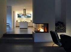 Open fireplace, modern kitchen, dark floors…half wall option next to short sta… - Home Page Interior, Home, Home Fireplace, Modern Kitchen, Fireplace Design, Kitchen Fireplace, House Interior, Modern Fireplace, Home And Living