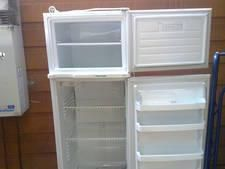 FOR SALE.. Fisher & paykel -213LT Fridge/Freezer in good working order,last two botton plastic shelves in fridge have boken, been repaired,clean & ready to go, $100