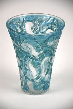 RENE LALIQUE 'SENART' A clear and frosted glass vase with blue patina, model introduced 1934 Marcilhac 1098 8.28 in.(20.7 cm.) high  etched R. LALIQUE