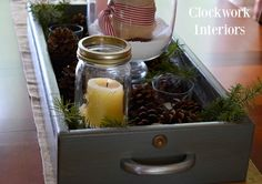 SIMPLE winter decor by clockworkinteriors.com -- upcycled desk drawer, pine boughs, ball jar/candles and pine cones.
