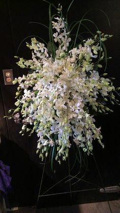 Dendrobium orchids, sympathy spray. Floral designs by garden delights Franklin tn 615-599-9950