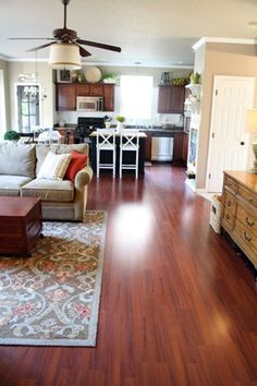 I love the coziness + cleanliness of this open living area!