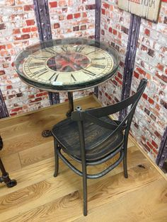 Our Clock Dining Table is made from solid wood and cast metal with toughness glass its hand made and very unique with battery operated clock.