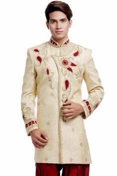 The 'chic' Biscuit colored Indo Western is stitched to perfection for the wedding eve. The linear patterns on the collar, the golden work in detail all over the outfit and the circular striped pattern on the wrist in golden completes the garment as the perfect one. The product price is inclusive of an Indo Western and a pair of brijes only. #sherwani #groomwear #delhigroom #indowestern #menswear #wedding #tobegroom