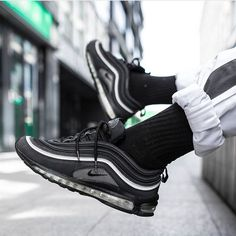 Blacked out beauty! As you can see the Air Max 97 not only looks good in gold and silver. Sometimes a clean black is all you need - especially with some reflective accents! by @lucky__luciano____ #sneakersmag #nike #nikeair #airmax97