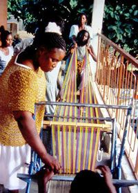 Weavearealpeace.org Women preparing loom for weaving in Ghana