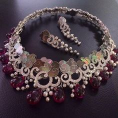 Van Cleef and Arpels Diamonds, Rubies, Mother of pearls for clouds and White pearls. Mounted on White gold, beautiful work!