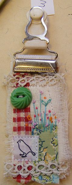 bookmark...or altered book page inspiration. Finally an idea to use all the garter's in my mom's stuff!  :)